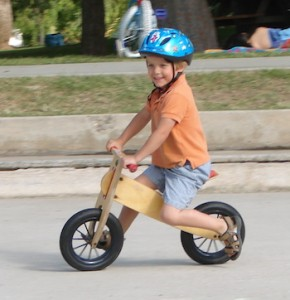 child on balance bike